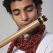 Stock Photo: Mplaying flute