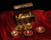 Gold coins and diyas — Stock Photo