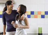 Friends having fun in the kitchen — Stock Photo