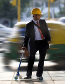 Man on a toy scooter — Stock Photo