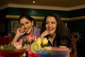 Friends enjoying a meal — Stock Photo