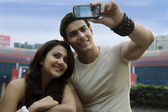 Couple clicking their photograph — Stock Photo