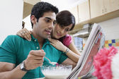Couple sitting in the kitchen — Stock Photo