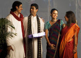 People exchanging gifts on Diwali — Stock Photo