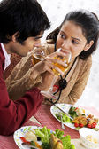 Couple enjoying a meal — Stock Photo