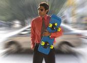 Executive with a skateboard — Stock Photo