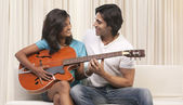 Man and woman playing the guitar — Stock Photo