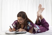 Woman writing notes — Stockfoto