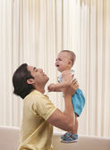 Man with a baby — Stock Photo