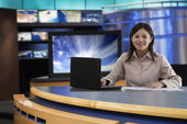 Portrait of female anchor in newsroom — Stock Photo