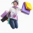 Woman jumping with shopping bags — Stock Photo #42857563