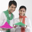 Couple holding a tray of colours — Stock Photo