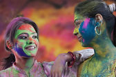 Women's faces covered in holi colours — Stock Photo