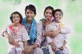 Family posing after playing holi — Stock Photo