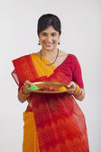 A Rajasthani woman holding a tray — Stock Photo