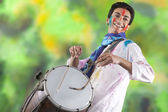 Man playing on a dhol — Stock Photo