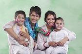 Family posing after playing holi — Stockfoto