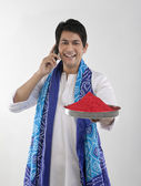 Man holding a tray of colours — Stock Photo