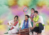 Friends playing music during holi — Stock Photo