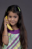 Girl using a banana as a phone — Stock Photo