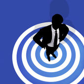 Businessman standing on a bulls eye — Stock Photo