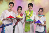 Friends holding trays with colours — Foto de Stock