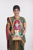 Maharashtrian woman holding a Ganesh idol — Stock Photo