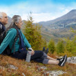 Old couple with hiking gear — Stock Photo