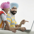 Father and son looking at laptop — Stock Photo #43488721