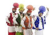 Sikh men dancing — Stock Photo