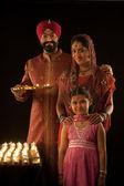 Sikh family with diyas — Stock Photo