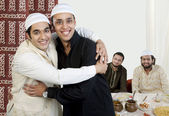 Muslim men greeting each other — Stock Photo