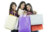 Girls with shopping bags posing — 图库照片