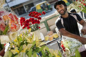 Florist at the flower shop — Stock Photo