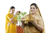 Mother and daughter making an offering — Stock Photo