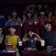 People watching a movie with 3D glasses — Stock Photo #43743069