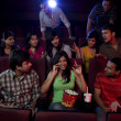 People watching a movie with 3D glasses — Stock Photo