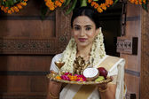 South Indian woman holding a tray — Stock Photo