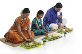 Indian family having lunch — Stock Photo