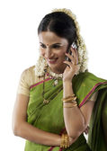 South Indian woman talking on a mobile phone — Stock Photo