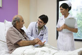 Doctor checking a patient — Stock Photo