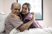 Wife embracing her husband at the hospital — Stock Photo