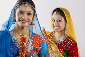 Gujarati women with dandiya sticks — Stock Photo