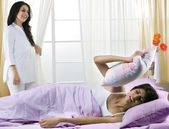 Mother waking her daughter up in the morning — Stock Photo