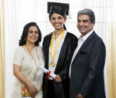 Parents with their graduated daughter — Stock Photo