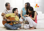 Family in living room — Stock Photo