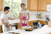 Brother and sister in the kitchen — Stock Photo