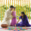 Family making a rangoli — Stock Photo #43777191