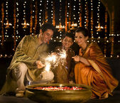 Family celebrating Diwali — Stock Photo