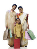 Bengali family with shopping bags — ストック写真